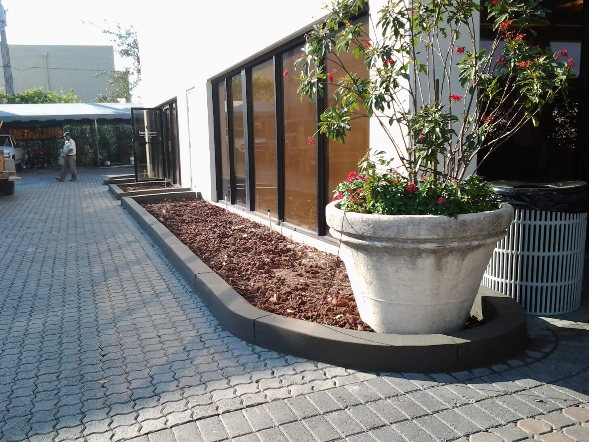 Commercial concrete curbing, driveways, patios, sidewalks, decorative garden