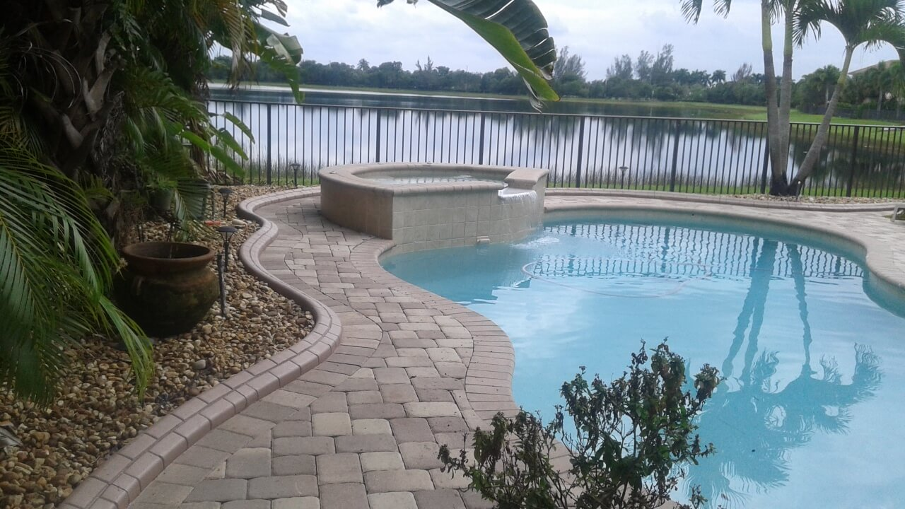 Royal Palm Pool decks curbing stones rocks mulch