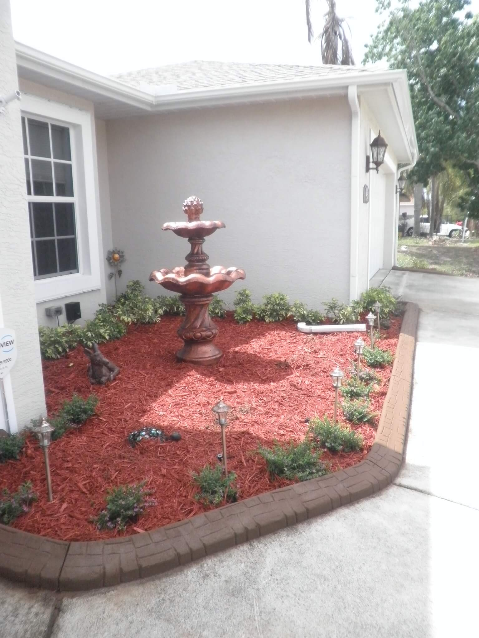 Loxahatchee, decorative concrete curbs installers, flower beds, stones