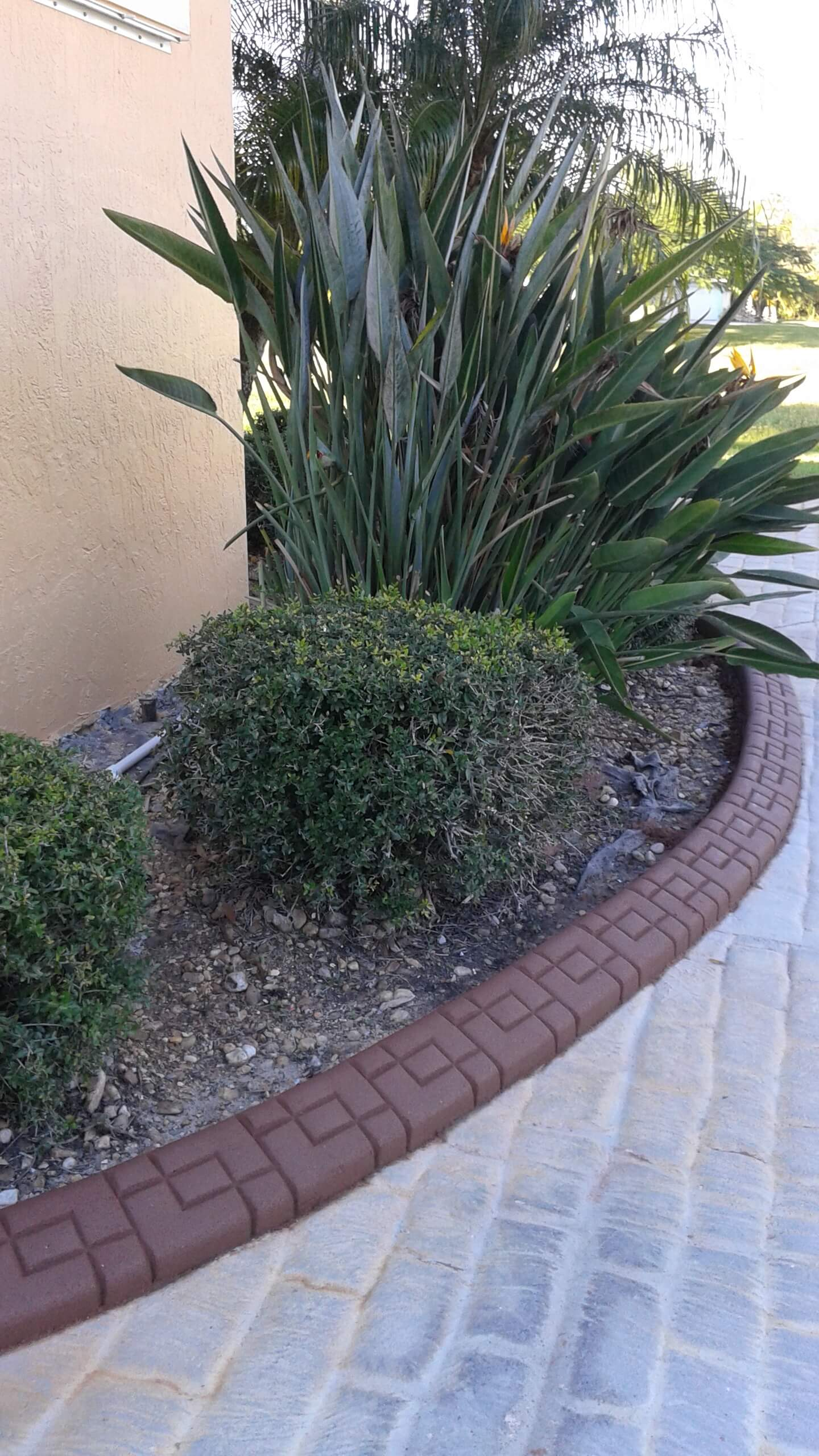Curbing edging walkways and driveways color and design